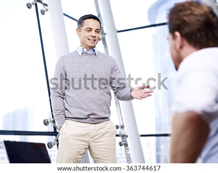 caucasian business people talking having a discussion conversation in office. - stock photo
