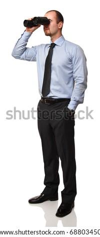caucasian businessman standing and holding classic binocular - stock photo
