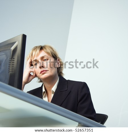Caucasian businesswoman looking at computer monitor. - stock photo