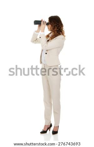 Caucasian businesswoman looking through binoculars. - stock photo