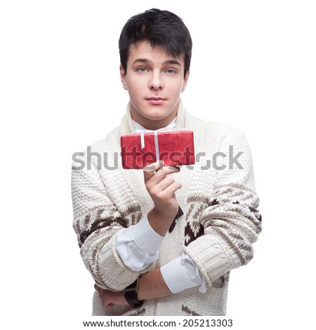 caucasian casual young man holding gift. isolated on white - stock photo