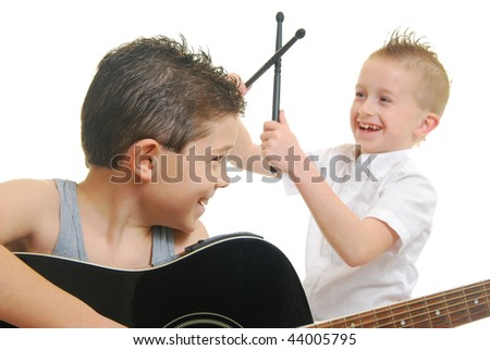 Caucasian children playing music isolated on white - stock photo