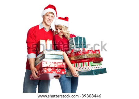Caucasian couple doing christmas shopping and carrying gifts - stock photo