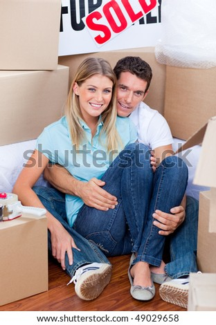 Caucasian couple embracing after move in at home - stock photo