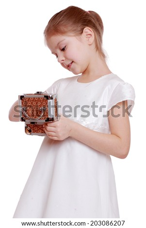 Caucasian cute little girl in an elegant white dress holding a box with jewelry isolated on white - stock photo