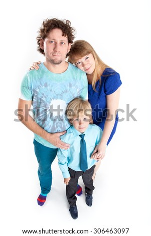 Caucasian family from father, mother and son, portrait on white background, full-length - stock photo