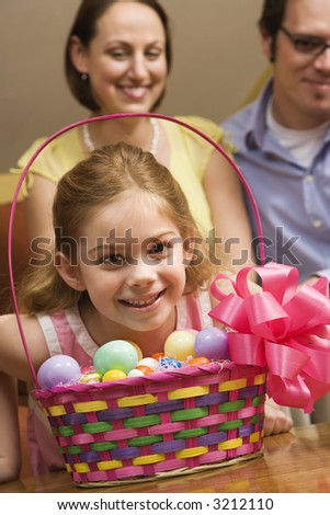 Caucasian family with girl and Easter basket. - stock photo