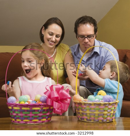 Caucasian family with looking at Easter baskets. - stock photo