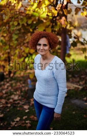 Caucasian farmer woman outdoor near a vine in the autumn - stock photo