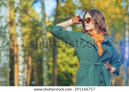 Caucasian Female Brunette Model Posing in Autumn Forest with Sunglasses. Horizontal  Image Composition - stock photo