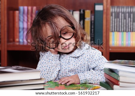 caucasian girl bored and sleeping in the library - stock photo