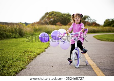 caucasian girl riding her bycicle in the park - stock photo