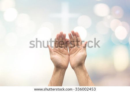 caucasian hands of man prayer on blurred bright color pastel background with bokeh christmas lights:hand palm up open receiving power from god.religion abstract concept.faith and strength conceptual. - stock photo
