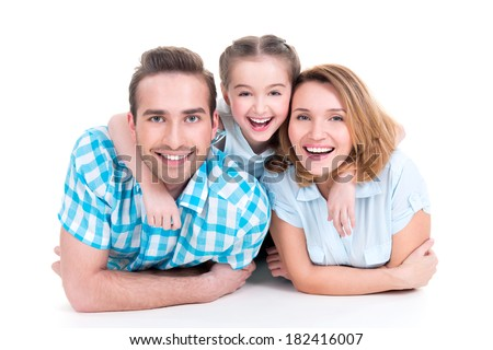 Caucasian happy smiling young family with little girl  lying down on the  floor - stock photo