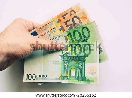 Caucasian human hand holding 300 Euros. - stock photo