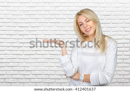 Caucasian isolated blond woman presenting with her hands - stock photo