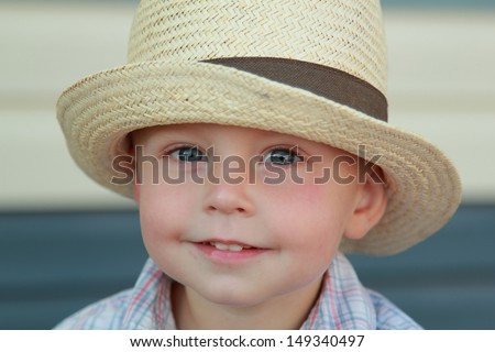 caucasian little boy in a summer hat outdoors - stock photo