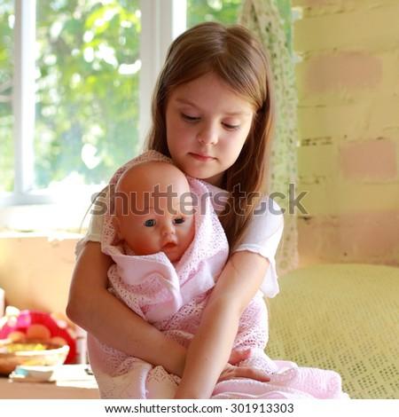 Caucasian lovely little girl in her new room - stock photo