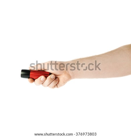 Caucasian male hand holding a , composition isolated over the white background - stock photo