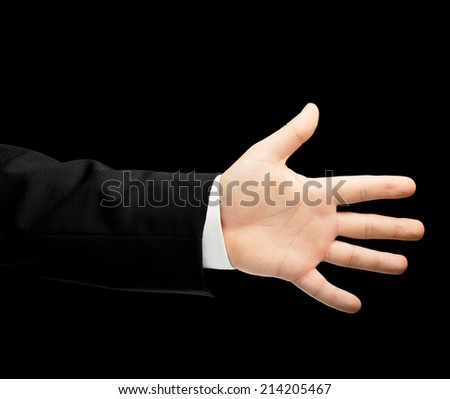 Caucasian male hand in a business suit showing number five with fingers, low-key lighting composition, isolated over the black background - stock photo