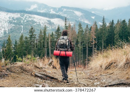 caucasian male hiking in mountains - stock photo