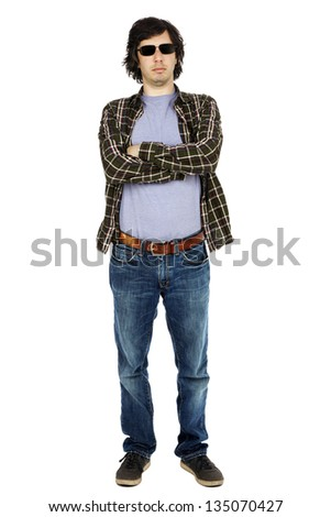 Caucasian male in his early 30's dressed in a casual attire, apparently looking at the camera through his sunglasses with a serious expression. Isolated on white background. - stock photo