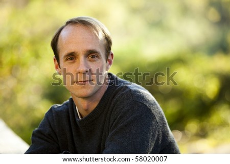 Caucasian male standing alone thinking - stock photo