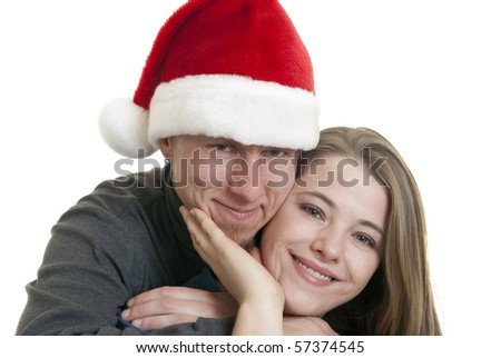 Caucasian male wearing a Santa hat - stock photo