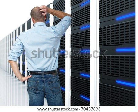 caucasian man back view and huge data center 3d - stock photo