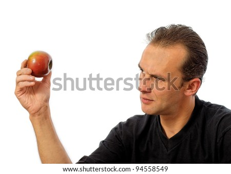 caucasian man holding an apple, over white - stock photo