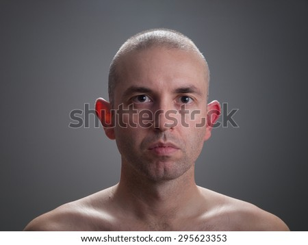 caucasian man looking at camera isolated on dark background - stock photo