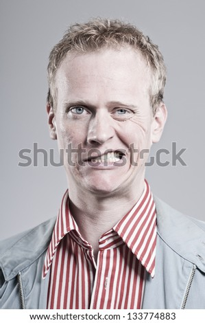 Caucasian Man Making A Weird Face - stock photo