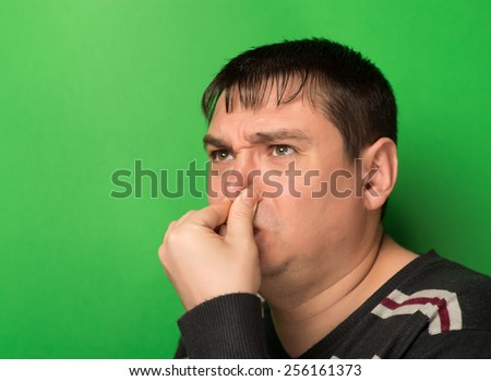 Caucasian man  pinches his nose - stock photo