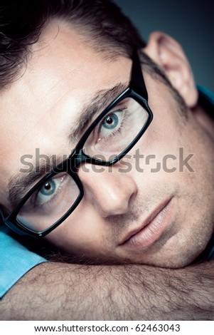 Caucasian man portrait with eyeglasses - stock photo
