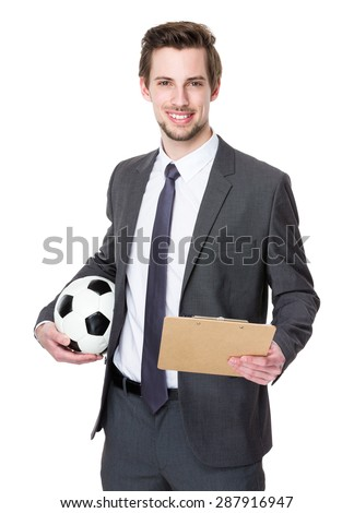 Caucasian scooer manager holding with football and clipboard - stock photo