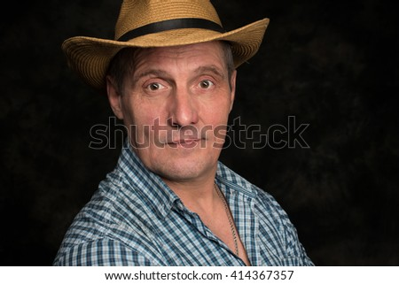 Caucasian senior man of 60 years old standing against gray background - stock photo
