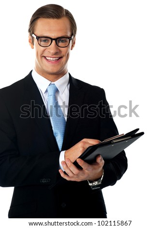 Caucasian smiling young businessman holding a folder isolated on white - stock photo