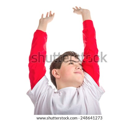 Caucasian smooth-skinned boy is stretching raising his arms and hands and looking up - stock photo
