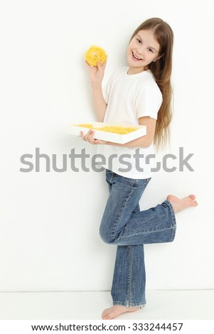 Caucasian teen girl holding pasta - stock photo