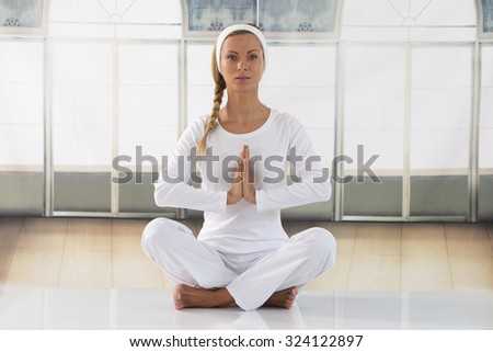 caucasian woman exercising yoga meditating  - stock photo