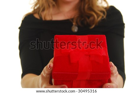 Caucasian woman giving a red gift. Shallow depth of field. Focus on present. - stock photo