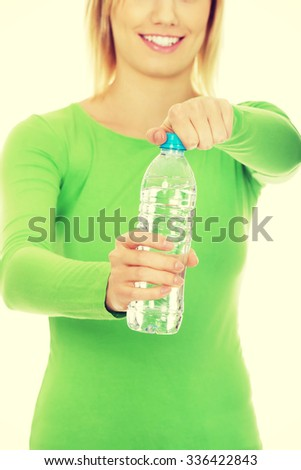 Caucasian woman holding a bottle of water. - stock photo
