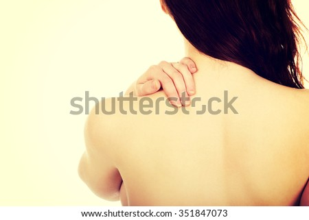 Caucasian woman holding her back. - stock photo