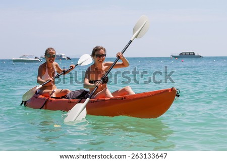 Caucasian woman is kayaking in sea at Thailand - stock photo