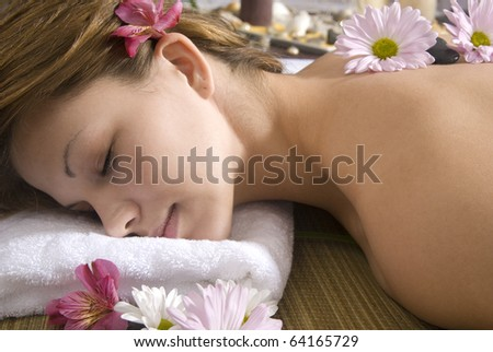 Caucasian woman resting at day spa waiting for massage. - stock photo