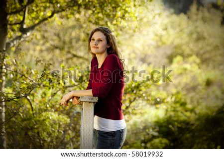 Caucasian woman thinking on wooden bridge - stock photo