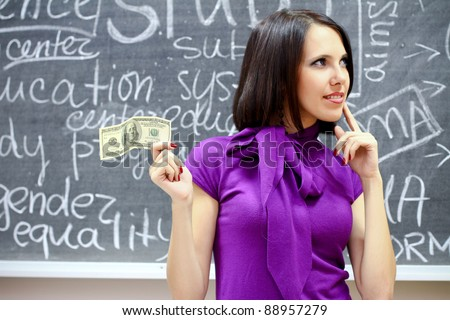 Caucasian woman with dollar note - stock photo