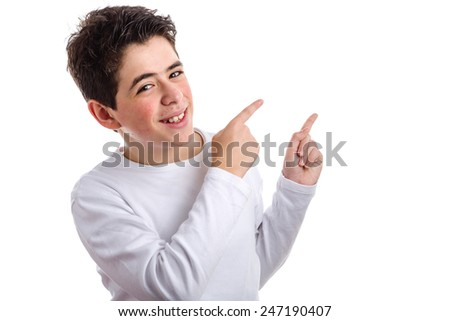 Caucasian young boy with acne in a white long sleeve t-shirt double pointing up to his left side with both forefingers - stock photo