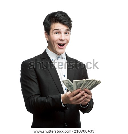 caucasian young smiling businessman holding money isolated on white - stock photo