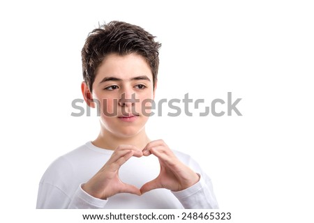 Caucasian young Smooth-skinned boy  in a white long sleeved t-shirt making hand heart gesture - stock photo
